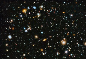 Click to enlarge. Hubble Ultra Deep Field 2014 - Image Credit: NASA, ESA, H.Teplitz and M.Rafelski (IPAC/Caltech), A. Koekemoer (STScI), R. Windhorst(ASU), Z. Levay (STScI) -- Galaxies fill the Hubble Ultra Deep Field 2014. The dimmest galaxies are more than 10 billion times fainter than stars visible to the unaided eye and represent the Universe in the extreme past, a few 100 million years after the Big Bang. The image itself was made with the significant addition of ultraviolet data to the Hubble Ultra Deep Field, an update of Hubble's famous most distant gaze toward the southern constellation of Fornax. It now covers the entire range of wavelengths available to Hubble's cameras, from ultraviolet through visible to near-infrared. Ultraviolet data adds the crucial capability of studying star formation in the Hubble Ultra Deep Field galaxies between 5 and 10 billion light-years distant.
