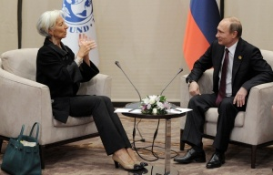 Lagarde, Putin: accomplices to murder (--Mikhail Klimentyev/TASS