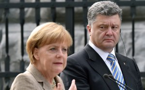 Angela Merkel, Petro Poroshenko (--.telegraph.co.uk)