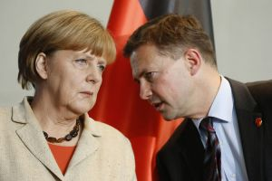 Angela Merkel chats with her Chief Spokesman Steffen Seibert (--Bloomberg/Thomas Trutschel/Getty Images)
