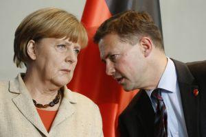 Angela Merkel chats with her Chief Spokesman Steffen Seibert (--Bloomberg/Thomas Trutschel/Getty Images)