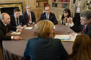 Study the photo closely. It appears Porkoshenko is making a point, while Hollande and Merkel, heads turned toward him, are dutifully listening. How is it humanly possible that these two Heads of State can deal so calmly with a mass murderer? -- Quemado Institute.