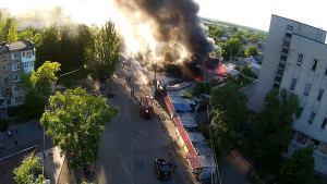 Ukraine shells residential areas (--Graham Phillips / thephaser.com)
