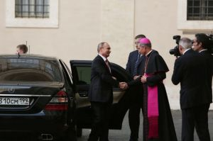 Archbishop Georg Gaenswein greets Russian president Vladimir Putin at the Vatican, June 10, 2015. (--Bohumil Petrik/CNA)