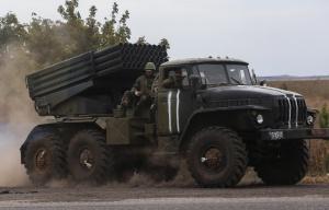 Ukrainian serviceman riding on a surface-to-surface missile complex Grad (--EPA/Konstantin Grishin)