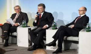 "Kiev regime leader Petro Poroshenko (center) and his sidekick, ""Prime Minister"" Artseniy Yatsenyuk. (--Strategic Culture Foundation)"
