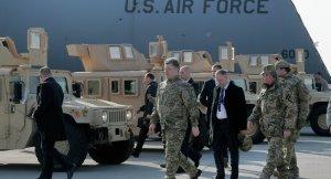 Kiev regime leader Petro Poroshenko walks by US armored Humvees at Boryspil Airport, Kiev. (--Sputnik)