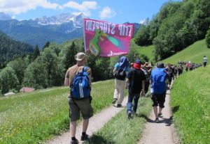 Protesters carry a banner that reads Stop TTIP on their way down an alpine path after trying - and failing -  to reach the G-7 venue in Schloss Elmau hotel (--newstimes.com)