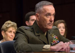 Gen. Joseph F. Dunford, Jr. listens to opening statements during Senate Armed Services Committee hearing on his nomination as chairman of the Joint Chiefs of Staff, July 9, 2015. Behind him are wife, Ellyn, son Patrick and niece, Jenna Sartucci. (--Joe Gromelski/Stars and Stripes)