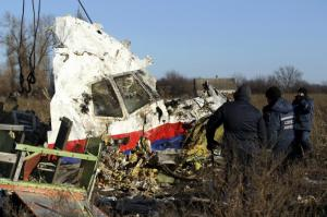 Local workers transport a piece of wreckage from flight MH17 at the site of the plane crash near the village of Hrabove (Grabovo) in Donetsk region, eastern Ukraine on Nov. 20, 2014. (--Reuters/Antonio Bronic)