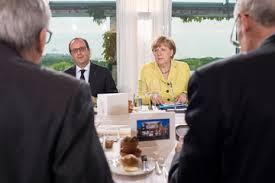 Francois Hollande, Angela Merkel (--zimbio.com)