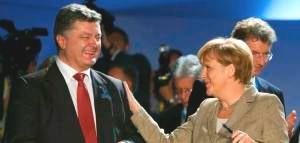 Petro Porkoshenko, Angela Merkel (--REUTERS/Yves Herman)