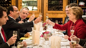 German Chancellor Angela Merkel and French President Francois Hollande toast during a private dinner in a restaurant in Berlin. (--cbc.ca)
