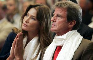 "France's former first lady Carla Bruni-Sarkozy and then foreign minister Bernard Kouchner at inauguration of Buddhist Lerab Ling temple in Roqueredonde, France, also attended by the Dalai Lama. ""I told him he was always welcome in France,"" said Kouchner, who met the Dalai Lama briefly afterwards. (--AFP/GETTY)"