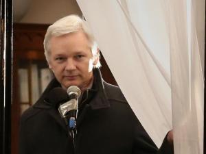 Julian Assange at the Ecuadorean embassy, London. (--Peter Macdiarmid/Getty Images)