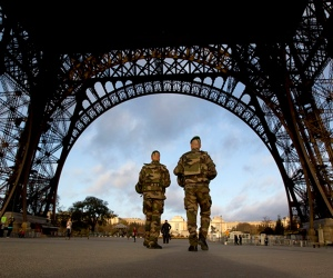 French soldiers at Eiffel Tower, closed for national mourning, Nov. 15, 2015. (AP/Peter Dejong)