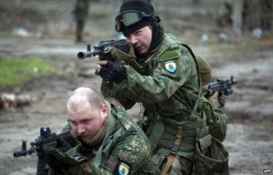 Volunteers from ultranationalist Azov battalion train near Mariupol. (http://catholicchurchapologetics.yuku.com)