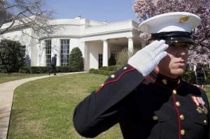 Marine salutes man autside Oval Office (--whitehouse.gov)