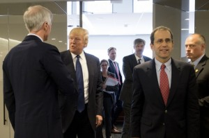 Donald Trump speaks with Washington Post Publisher Fred Ryan, left, as he departs a meeting with the editorial board of The Washington Post. Editorial page editor Fred Hiatt is on the right. (--Bonnie Jo Mount/Washington Post)