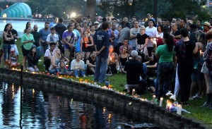 People lay candles small vigil for victims. (--Monivette Cordairo)