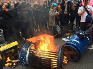 Protesters burn trashcan, January 20, 2017 (--Breitbart)